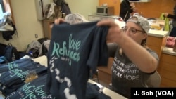 T-shirt sales contribute to the Love Week effort to help refugees.