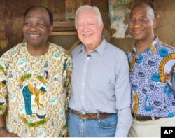 Feb. 15, 2007. Nasarawa, Nigeria. Former U.S. President and Founder of The Carter Center Jimmy Carter, stands with Carter Center Vice President of Health Programs, Dr. Donald Hopkins (right) and Guinea worm partner, former Nigerian Head of State General Y