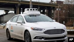 An Argo self-driving car is tested in Pittsburgh, Pennsylvania, Jan. 22, 2018. Argo is a company owned by Ford.