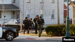 Police outside house in which suspect Bradley Williams-Stone, 35, is believed to be hiding, Pennsburg, Pennsylvania, Dec. 15, 2014.