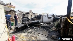 Soldiers clean the wreckage of a TransAsia Airways turboprop plane that crashed on Taiwan's offshore island Penghu on July 25, 2014.