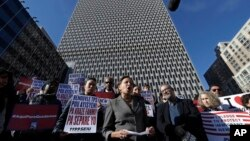 Immigration advocates rally, Nov. 21, 2017, in front of the Jacob J. Javits Federal Building in New York to protest the decision from the Department of Homeland Security to terminate Temporary Protected Status for people from Haiti.