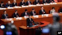 Chinese President Xi Jinping delivers a speech at the closing session of the annual National People's Congress (NPC) at the Great Hall of the People in Beijing, Tuesday, March 20, 2018.
