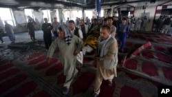 Men carry the coffin of a victim of a suicide attack at a Shiite mosque, Aug. 26, 2017, in Kabul, Afghanistan.