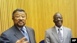 AU Commission Chairman Jean Ping (l) and the acting Peace and Security Council Chairman, Nigerian Ambassador B. Paul Lolo brief reporters at African Union HQ, March 23, 2012