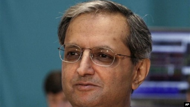 Citigroup CEO Vikram Pandit prepares for a TV interview after he rang the opening bell on the floor of the New York Stock Exchange, June 18, 2012.