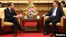 Tổng thống Pháp Emmanuel Macron (trái) gặp Chủ tịch Trung Quốc Tập Cận Bình tại Bắc Kinh ngày 8/1/2018.