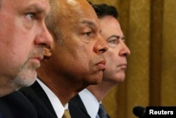 FILE - U.S. National Counterterrorism Center Director Nicholas Rasmussen, Homeland Security Secretary Jeh Johnson and FBI Director James Comey, left to right, testify before a House Homeland Security Committee hearing on Capitol Hill in Washington, July 14, 2016.