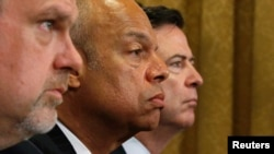 FILE - From left, U.S. National Counterterrorism Center Director Nicholas Rasmussen, Homeland Security Secretary Jeh Johnson and FBI Director James Comey testify before a House Homeland Security Committee hearing on Capitol Hill in Washington, July 14, 2016.
