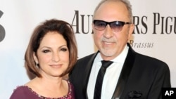 FILE - Gloria Estefan and Emilio Estefan at the 68th annual Tony Awards at Radio City Music Hall in New York.
