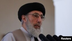 FILE - Afghan warlord Gulbuddin Hekmatyar speaks during a welcoming ceremony at the presidential palace in Kabul, Afghanistan, May 4, 2017.