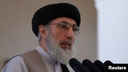 FILE - Afghan warlord Gulbuddin Hekmatyar speaks at the presidential palace in Kabul, Afghanistan, May 4, 2017.