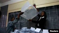 Electoral officials empty ballot box before counting votes at polling center, Antananarivo, Oct. 25, 2013.