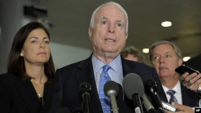 Sen. John McCain, R-Ariz., ranking Republican on the Senate Armed Services Committee, center, flanked by fellow committee members, Sen. Kelly Ayotte, R-N.H., left, and Sen. Lindsey Graham, R-S.C., right, speaks on Capitol Hill in Washington, Nov. 27, 2012