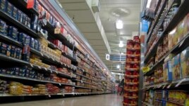 About 80 percent of the packaged foods on American supermarket shelves contain ingredients from genetically modified organisms, says the Grocery Manufacturers Association