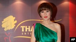 In this March 24, 2010, file photo, Thai Princess Ubolratana poses for a photo at the Thai Gala Night in Hong Kong. (AP Photo/Kin Cheung, File)