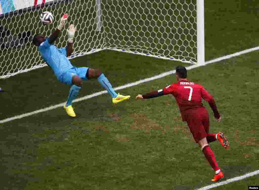 Ghana's goalkeeper Fatau Dauda denies Portugal's Cristiano Ronaldo with this tremendous save at the Brasilia national stadium in Brasilia, June 26, 2014.
