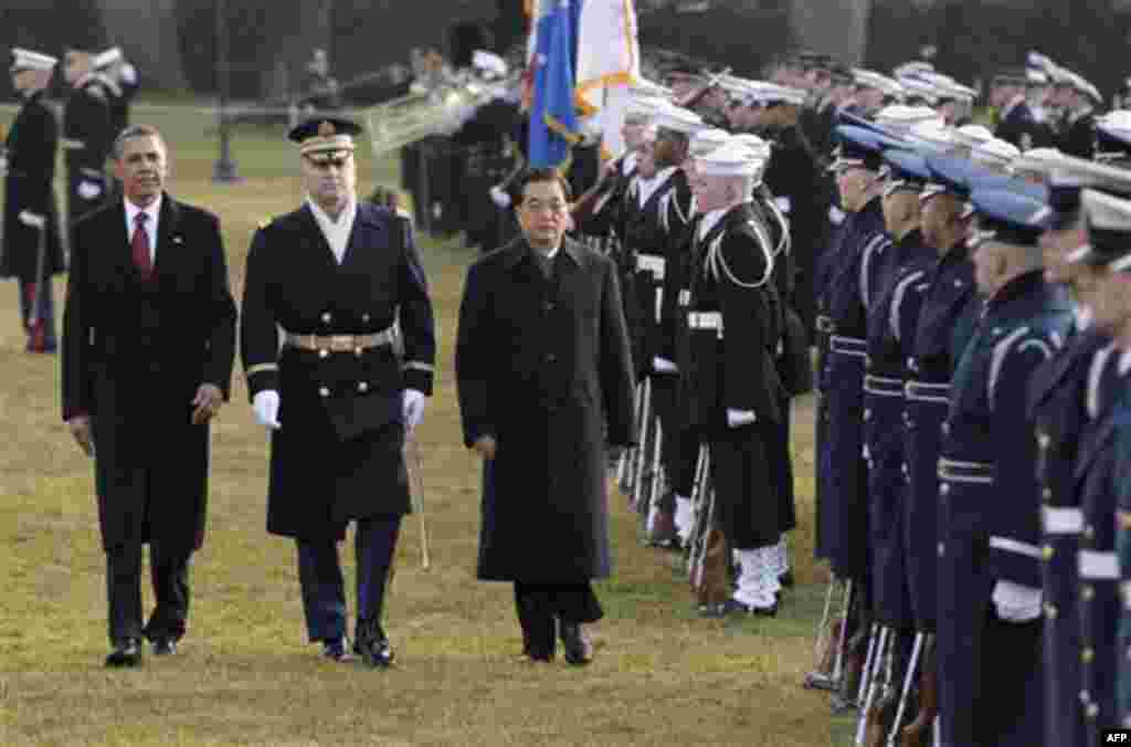 President Barack Obama and China's President Hu Jintao inspect the troops during a state arrival ceremony at the White House in Washington, Wednesday, Jan. 19, 2011. (AP Photo/J. Scott Applewhite)