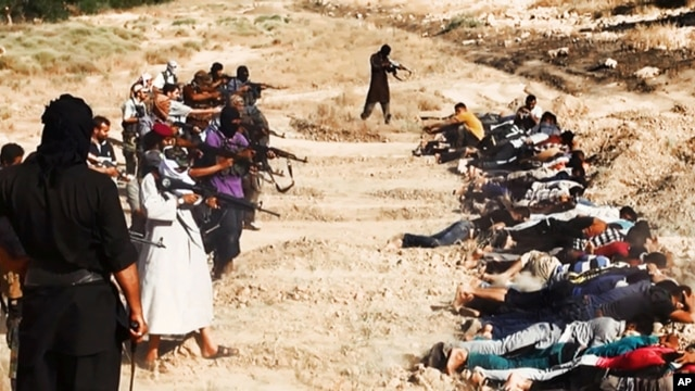 This image appears to show ISIL militants taking aim at captured Iraqi soldiers. It was posted on a militant website June 14, 2014.