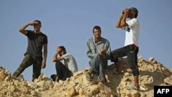 Лівійські повстанці після бою в західному районі країни
