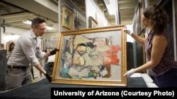 University of Arizona staff members prepare to examine Willem de Kooning's work after it was returned to the school.