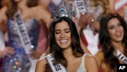 Miss Colombia Paulina Vega smiles as the the crown is placed on her head as she becomes Miss Universe during the Miss Universe pageant in Miami, Sunday, Jan. 25, 2015.