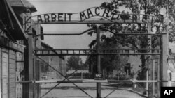 FILE - This undated photo shows the main gate of the Nazi concentration camp Auschwitz, in Poland, which was liberated by the Russians in January 1945.