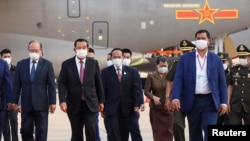 Cambodian Prime Minister Hun Sen arrives to receive a shipment of 600,000 doses of the coronavirus disease (COVID-19) vaccines donated by China from ambassador Wang Wentian, at the Phnom Penh International Airport, in Phnom Penh, Cambodia February 7, 2021. (Reuters)