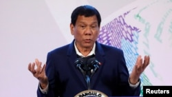FILE - Philippines' President Rodrigo Duterte gestures during a news conference at the Association of South East Asian Nations (ASEAN) summit in Pasay, metro Manila, Philippines, Nov. 14, 2017.