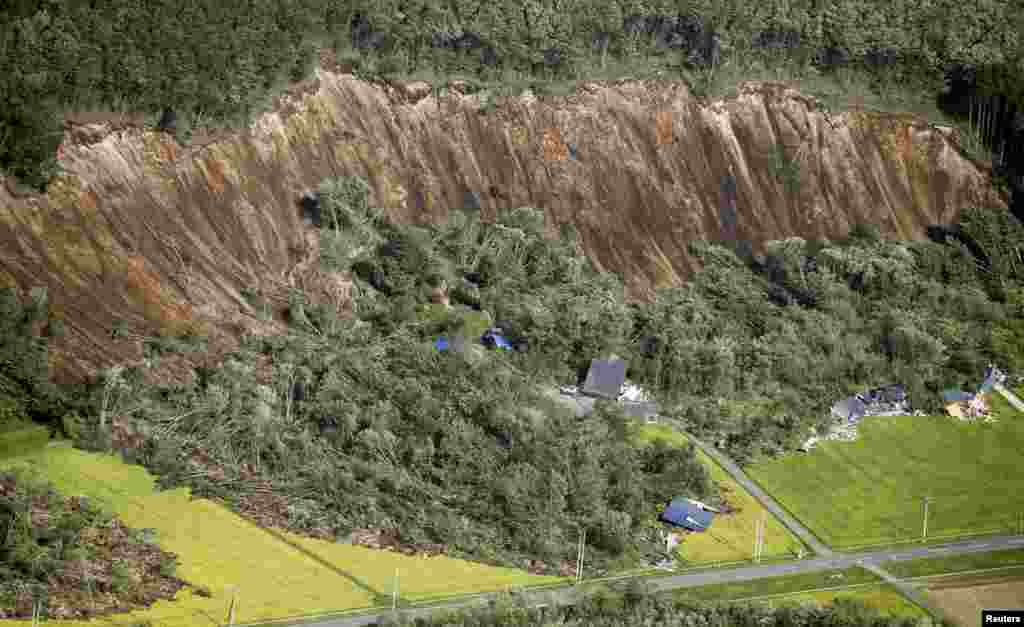 Houses damaged by a landslide caused by an earthquake are seen in Atsuma town on Japan's northern island of Hokkaido, in this photo taken by Kyodo.