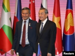 Singapore's Foreign Minister Vivian Balakrishnan and Chinese Foreign Minister Wang Yi