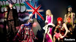 Mannequins displaying creations by designer Jean Paul Gaultier are seen during the press visit of the Jean Paul Gaultier Exhibition at the Grand Palais in Paris, March 30, 2015.