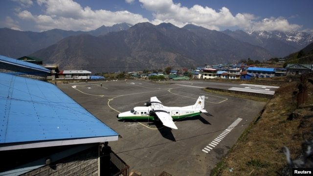 FILE - A Twin Otter aircraft belonging to Tara Air is pictured at Tenzing Hillary Airport, in Lukla, approximately 2800 meters above sea level, in Solukhumbu district, Nepal. The missing plane was flying from Pokhara, a major tourist center located about 200 kilometers west of Kathmandu, to Jomsom, a popular spot for hikers.