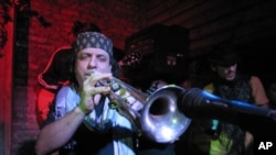 Frank London blows his horn for Haiti Relief at Mehanata, an alternative club in New York.