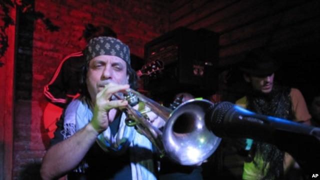 Frank London blows his horn for Haiti Relief at Mehanata, an alternative club in New York.