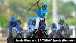 Victor Espinoza aboard American Pharoah celebrates their victory the 141st Kentucky Derby at Churchill Downs, May 2, 2015. (Credit: Jamie Rhodes-USA TODAY Sports)