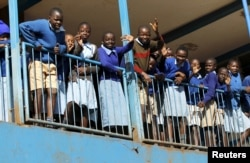 Students are seen outside their classrooms on the second week of a national teachers' strike, at Olympic Primary School in Kenya's capital Nairobi, September 9, 2015.