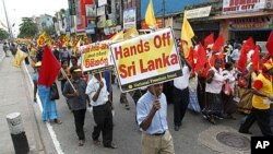 Thousands of flag-waving Sri Lankans used a May Day rally Sunday to protest a UN report on alleged crimes committed during the country's civil war, Colombo, May 1, 2011