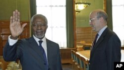 Newly appointed UN-Arab League Envoy on Syria Kofi Annan waves to the media after shaking hand with France's Foreign Minister Alain Juppe, before the19th session of the Human Rights Council at the United Nations, in Geneva, February 27, 2012.