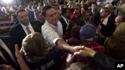 Supporters of Republican presidential candidate, former Massachusetts Gov. Mitt Romney cheer as he addresses a crowd at a campaign event, in Broomall, Pennsylvania, April 4, 2012. (AP)