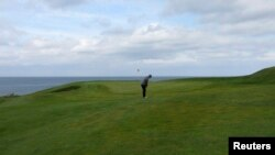 A golfer plays a shot on the Golfklubberinn Oddur golf course in Rekyavik June 5, 2013. About 10 percent of Iceland's population plays golf - a higher rate than the United States or Britain - making it the country's second most popular sport, after soccer.
