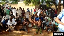 People sit on the ground after being freed by police from an Islamic rehabilitation centre in Ibadan, Nigeria in this picture released by Nigeria Police November 5, 2019. (Nigeria Police/Handout via REUTERS)