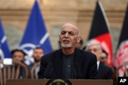 FILE - Afghan President Ashraf Ghani speaks during a news conference at presidential palace in Kabul, Afghanistan, Feb. 29, 2020.