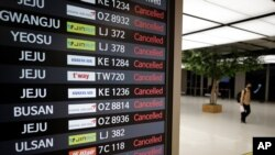 An electronic signboard shows canceled flights at the Gimpo Airport in Seoul, South Korea, Sept. 2, 2020.