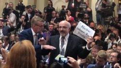 Activist Forcibly Removed Prior to Trump-Putin Press Conference