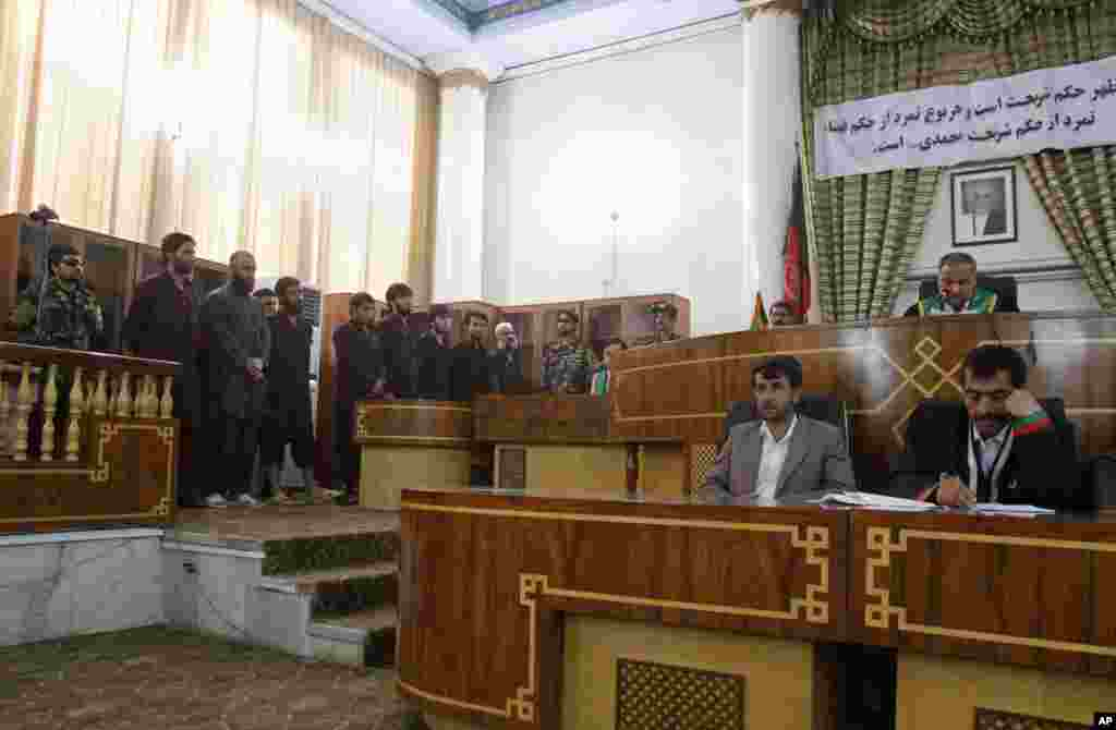 Defendants attend their trial at the Primary Court in Kabul, Afghanistan, Wednesday, May 6, 2015.