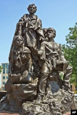 The Native American guide Sacagawea stand with explorers Meriwether Lewis and William Clark on a sculpture. (FILE PHOTO)