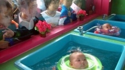 Chinese babies practice swimming in Jiesou.
