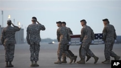 An Army carry team carries the transfer case containing the remains of Army Sgt. John Castro, of Andrews, Texas, at Dover Air Force Base, DE Saturday, April 23, 2011