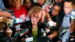 Agnes Callamard, U.N. special rapporteur on extrajudicial executions, talks to the media after her speech at a drug policy forum at University of the Philippines, May 5, 2017 in suburban Quezon city, northeast of Manila, Philippines. Callamard has rebuked Philippine President Rodrigo Duterte's deadly campaign against illegal drugs, saying world leaders have recognized it does not work.